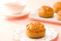 Cream puff and hot tea