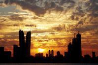 Bahrain highrise building in golden cloud