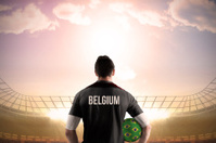 Belgium football player holding ball