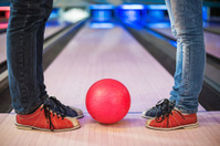 Legs with bowling ball.