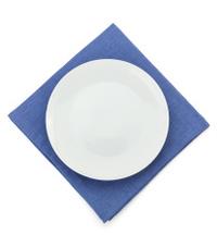 plate at napkin on white