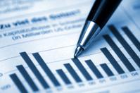Pen showing diagram on financial report/magazine (blue tone)