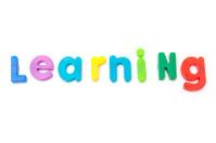 Learning written in magnetic letters.