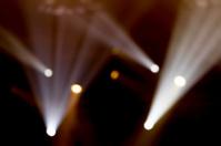 Defocused entertainment concert lighting on stage, bokeh.