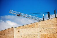 Crane behind the wall