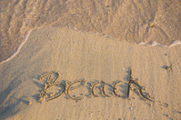 word Beach written on the beach