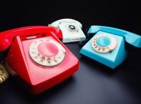 Three old telephones
