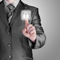 Businessman pushing virtual security button