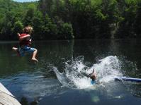 Kids Jumping In Lake