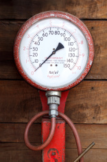 An old tire-pressure measuring gauge