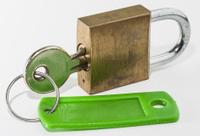 Old SIlver Key in Old Brass Padlock