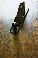 Old Iron Jack Plane On Polished Oak Surface