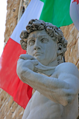 Statue of David with italian flag, by Michelangelo
