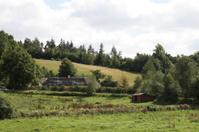 Farmhouse behind the hill