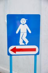 blue background of signs men's room.