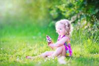 Funny girl eating ice cream in the garden