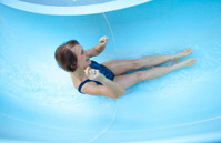 Senior Woman Sliding Down Water Slide