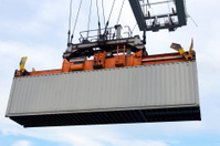 Sea container lifted by a harbor crane