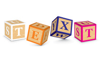 Word TEXT written with alphabet blocks