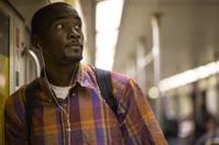 Anxious Looking Man on Subway Train