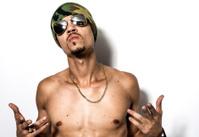 Black Male Hip Hop Rapper Attitude Sunglass Pose Against White