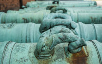 Elephant trunk handles on copper cannons