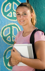 Girl standing in front of peace signs