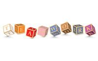 Word TEAMWORK written with alphabet blocks