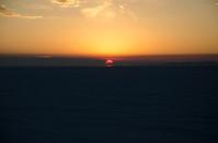 Orange Sun Rise through Clouds at Bonneville Salt Flats