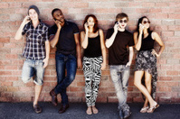 Group of hip young people talk on cellphones