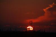 Sun setting behind Regina Oil Refinery in Saskatchewan