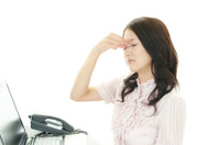 Business woman having a headache