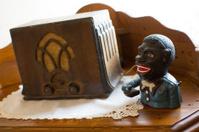 Vintage radio and money box