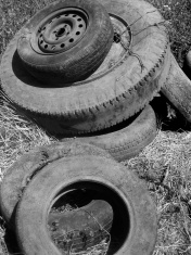 Abandoned Tires Vertical Black and White