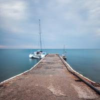 Minimalist Seascape. Boat at a dock.