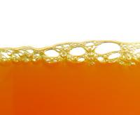 yellow bubbles in the orange juice