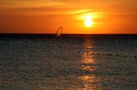 wind surfing under sunset sky