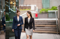 Chinese Career Businesswomen Walking in Downtown Hong Kong Finan
