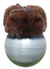 Fur winter hat on a plastic ball black.