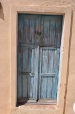 old grey wooden door in greece