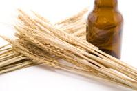 Wheat ear with glass bottle