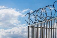 Razor wire over fence