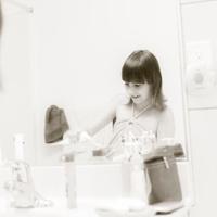Little girl brushing teeth in the bathroom