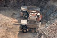 Excavating machine dumps gold mine ore Colorado