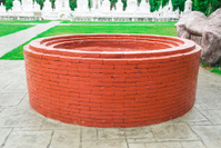 Brick Well in front of Ossuaries in Temple