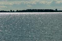 Summer sunlight over water