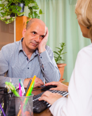 Elderly man with doctor in clinic
