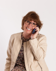 Professional Older Woman Smiling on Cell Phone