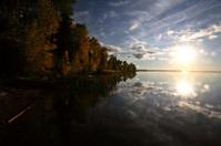 Sun rising over a Saskatchewan lake
