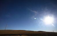 Sun setting behind Saskatchewan windfarm